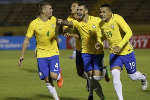 Brazil's Felipe Vizeu, center right, celebrates with his teammates Lyanco, from left, Richarlison and Leo Jaba, after scoring against Argentina in a U-20 South America qualifying soccer tournament for the 2017 South Korea U-20 World Cup, in Quito, Ecuador, Wednesday, Feb. 8, 2017. (AP Photo/Dolores Ochoa)