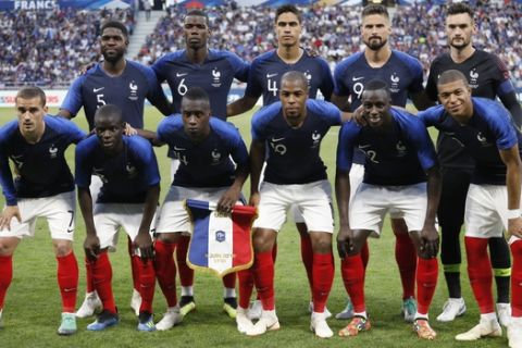 In this photo taken on Saturday, June 9, 2018, France players pose for a photo prior the friendly soccer match between France and USA at the Groupama stadium in Decines, near Lyon, central France (AP Photo/Laurent Cipriani)