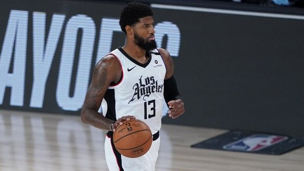Los Angeles Clippers' Paul George (13) dribbles the ball down court against the Dallas Mavericks during the first half of an NBA basketball first round playoff game Tuesday, Aug. 25, 2020, in Lake Buena Vista, Fla. (AP Photo/Ashley Landis, Pool)