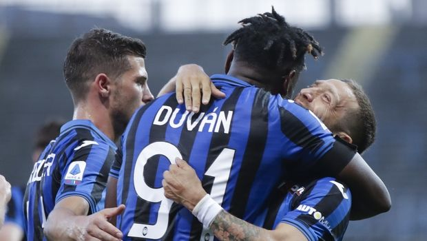 Atalanta's Duvan Zapata celebrates with his teammate Papu Gomez, right, after scoring his side's fourth goal during the Serie A soccer match between Atalanta and Sassuolo at the Gewiss Stadium in Bergamo, Italy, Sunday, June 21, 2020. Atalanta is playing its first match in Bergamo since easing of lockdown measures, in the area that has been the epicenter of the hardest-hit province of Italy's hardest-hit region, Lombardy, the site of hundreds of COVID-19 deaths. (AP Photo/Luca Bruno)
