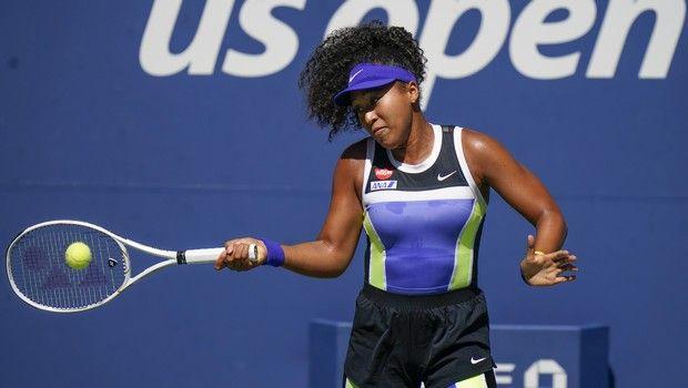Naomi Osaka, of Japan, returns a shot to Marta Kostyuk, of the Ukraine, during the third round of the US Open tennis championships, Friday, Sept. 4, 2020, in New York. (AP Photo/Seth Wenig)