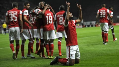 Braga's Ahmed Hassan, front on the pitch, celebrates after scoring the opening goal during the Europa League group F soccer match between SC Braga and FC Groningen at the Municipal stadium in Braga, Portugal, Thursday, Oct. 1, 2015.  (AP Photo/Paulo Duarte)