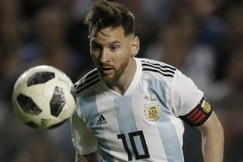 Argentina's Lionel Messi controls the ball during a friendly soccer match between Argentina and Haiti at the Bombonera stadium in Buenos Aires, Argentina, Tuesday, May 29, 2018. (AP Photo/Natacha Pisarenko)
