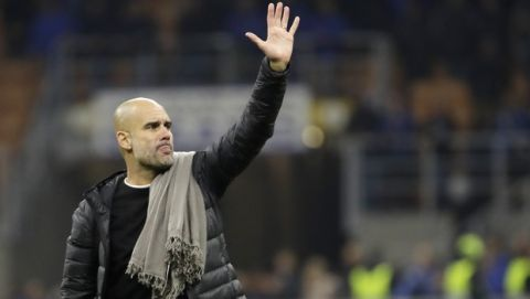 Manchester City's head coach Pep Guardiola waves fans during the Champions League group C soccer match between Atalanta and Manchester City at the San Siro stadium in Milan, Italy, Wednesday, Nov. 6, 2019. (AP Photo/Luca Bruno)