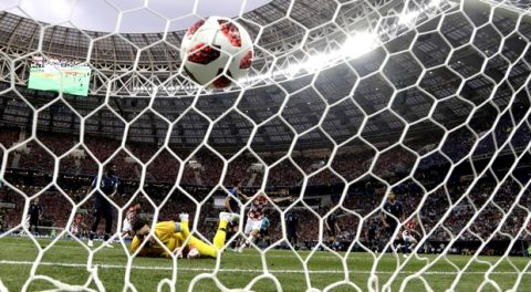 France goalkeeper Hugo Lloris looks at the ball as Croatia's Ivan Perisic scores his side's opening goal, during the final match between France and Croatia at the 2018 soccer World Cup in the Luzhniki Stadium in Moscow, Russia, Sunday, July 15, 2018. (AP Photo/Petr David Josek)