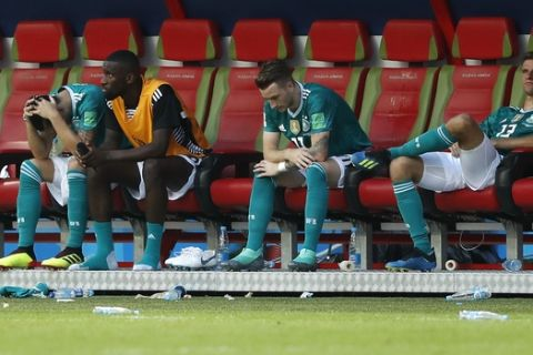 German players sit on their bench after they lose the group F match between South Korea and Germany, at the 2018 soccer World Cup in the Kazan Arena in Kazan, Russia, Wednesday, June 27, 2018. South Korea won the match 2-0. (AP Photo/Frank Augstein)