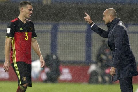 Belgium's coach Roberto Martinez, right, talks with his player Thomas Vermaelen during the World Cup Group H qualifying soccer match between Bosnia and Belgium at the Grbavica stadium in Sarajevo, Bosnia, Saturday, Oct. 7, 2017. (AP Photo/Amel Emric)