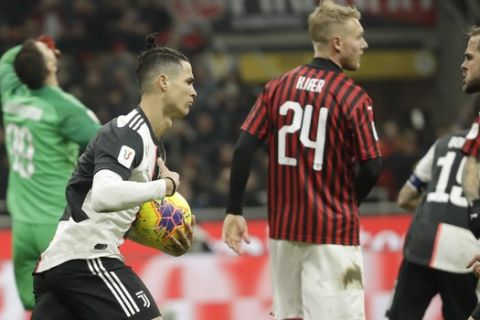 Juventus' Cristiano Ronaldo, second left, celebrates after scoring his side's opening goal from the penalty spot during an Italian Cup soccer match between AC Milan and Juventus at the San Siro stadium, in Milan, Italy, Thursday, Feb. 13, 2020. (AP Photo/Luca Bruno)