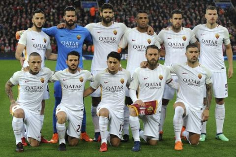 Roma players pose for a photo prior the Champions League semifinal, first leg, soccer match between Liverpool and Roma at Anfield Stadium, Liverpool, England, Tuesday, April 24, 2018. (AP Photo/Rui Vieira)