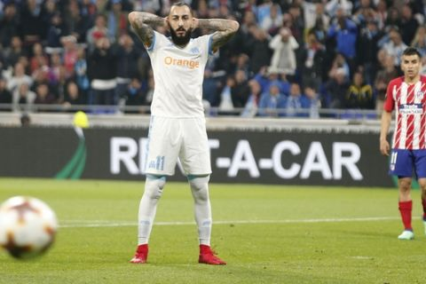 Marseille's Konstantinos Mitroglou, left, reacts as Atletico's Angel Correa looks on during the Europa League Final soccer match between Marseille and Atletico Madrid at the Stade de Lyon in Decines, outside Lyon, France, Wednesday, May 16, 2018. (AP Photo/Thibault Camus)