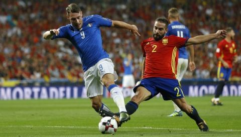 Italy's Andrea Belotti fights for the ball against Spain's Dani Carvajal during the World Cup Group G qualifying soccer match between Spain and Italy at the Santiago Bernabeu stadium in Madrid, Spain, Saturday, Sept. 2, 2017. (AP Photo/Francisco Seco)
