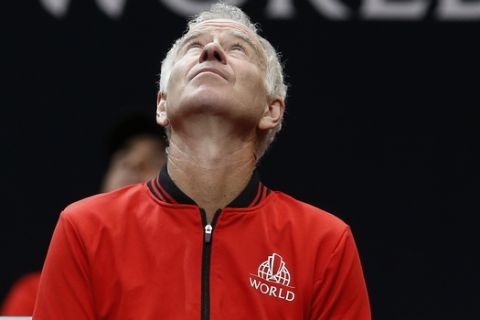 Team World's John McEnroe looks at the scoreboard during a men's singles tennis match against Team Europe at the Laver Cup, Friday, Sept. 21, 2018, in Chicago. (AP Photo/Jim Young)