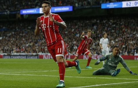 Bayern's James, left, celebrates after scoring his side's second goal during the Champions League semifinal second leg soccer match between Real Madrid and FC Bayern Munich at the Santiago Bernabeu stadium in Madrid, Spain, Tuesday, May 1, 2018. (AP Photo/Paul White)