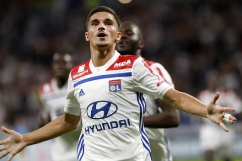 Lyon's Houssem Aouar celebrates after he scored a goal against Marseille during their French League One soccer match in Decines, near Lyon, central France, Sunday, Sept. 23, 2018. (AP Photo/Laurent Cipriani)