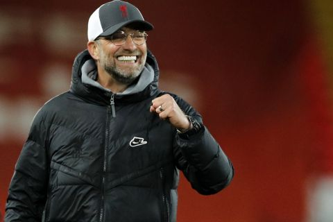 Liverpool's manager Jurgen Klopp celebrates at the end of the English Premier League soccer match between Liverpool and Southampton at Anfield stadium in Liverpool, England, Saturday, May 8, 2021. (Phil Noble/Pool via AP)