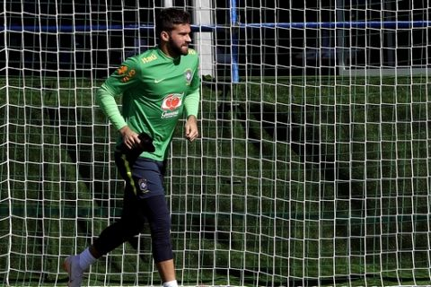 Brazil goalkeeper Alisson runs jogs during a training session in Sochi, Russia, Wednesday, June 13, 2018. Brazil will face Switzerland on June 17 in the group E for the soccer World Cup. (AP Photo/Andre Penner)