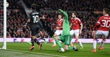 """""""Liverpool's Brazilian midfielder Philippe Coutinho (L) shoots past Manchester United's Spanish goalkeeper David de Gea (3rd L) to score their first goal during the UEFA Europa League round of 16, second leg football match between Manchester United and Liverpool at Old Trafford in Manchester, north west England on March 17, 2016. / AFP / OLI SCARFF        (Photo credit should read OLI SCARFF/AFP/Getty Images)"""""""