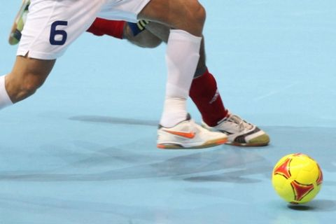 Gabriel of Brazil  left, and Fernandao of Spain gofor the ball during their FIFA Futsal World Cup final match in Bangkok, Thailand Sunday , Nov. 18, 2012. Brazil beat Spain 3-2.(AP Photo)
