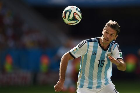 Argentina's defender Martin Demichelis eyes the ball during a quarter-final football match between Argentina and Belgium at the Mane Garrincha National Stadium in Brasilia during the 2014 FIFA World Cup on July 5, 2014. AFP PHOTO / PEDRO UGARTE        (Photo credit should read PEDRO UGARTE/AFP/Getty Images)