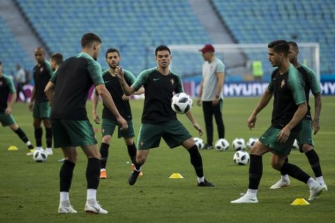 Portugal players play the ball during Portugal's official training on the eve of the group B match between Portugal and Spain at the 2018 soccer World Cup in the Fisht Stadium in Sochi, Russia, Thursday, June 14, 2018. (AP Photo/Francisco Seco)