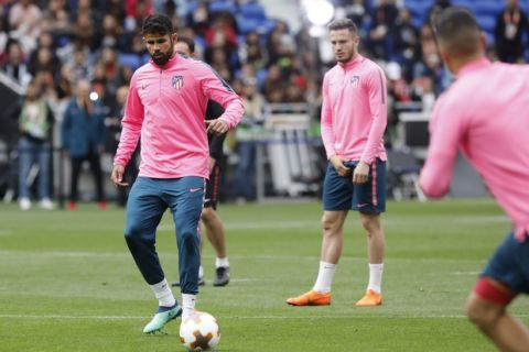 Atletico Madrid's Diego Costa, left, controls the ball during a training session at the Groupama stadium in Decines, outside Lyon, central France, Tuesday May 15, 2018. Atletico Madrid will play Marseille in the Europa League final on Wednesday. (AP Photo/Laurent Cipriani)