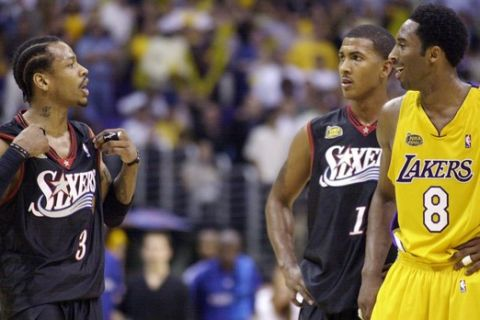 FILE - In this Friday, June 8, 2001, file photo, Philadelphia 76ers' Allen Iverson, left, argues with the Los Angeles Lakers' Kobe Bryant at the end of Game 2 of the NBA Finals in Los Angeles, as 76ers' Raja Bell looks on at rear. Iverson complained that the Lakers were holding him during the game. The Lakers went on to win 98-89 to even the series at 1-1. Bryant was killed in a helicopter crash on Sunday, Jan. 26, 2020. (AP Photo/Kim D. Johnson, File)