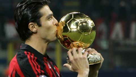 AC Milan's Brazilian forward Kaka kisses the Golden Ball prior the start of the Champions League, Group D soccer match between AC Milan and Celtic, at the San Siro stadium ,in Milan, Italy, Tueday, Dec.4, 2007. Kaka won the Golden Ball award after helping his club win the Champions League title this year with some standout performances. (AP Photo/Antonio Calanni)