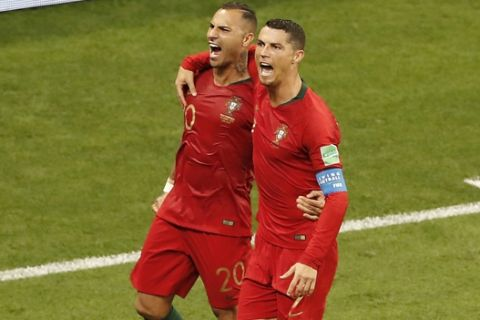 Portugal's Ricardo Quaresma, left, celebrates with his teammate Cristiano Ronaldo after scoring his side's first goal during the group B match between Iran and Portugal at the 2018 soccer World Cup at the Mordovia Arena in Saransk, Russia, Monday, June 25, 2018. (AP Photo/Darko Bandic)