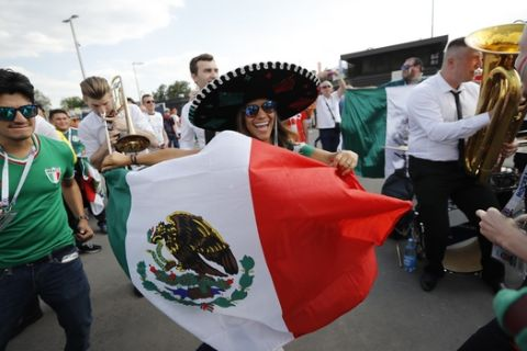 Mexico's football fans dance ahead of the group F match between Germany and Mexico at the 2018 soccer World Cup in the Luzhniki Stadium in Moscow, Russia, Sunday, June 17, 2018. (AP Photo/Alexander Zemlianichenko)