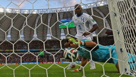 PORTO ALEGRE, BRAZIL - JUNE 15:  Goalkeeper Noel Valladares of Honduras scores an own goal, France's second, as he fumbles the ball over the line during the 2014 FIFA World Cup Brazil Group E match between France and Honduras at Estadio Beira-Rio on June 15, 2014 in Porto Alegre, Brazil.  (Photo by Quinn Rooney/Getty Images)