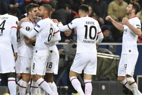 Frankfurt's Andre Silva, second left, celebrates with his teammates after scoring his side's second goal during the Europa League round of 32 second leg soccer match between FC Red Bull Salzburg and Eintracht Frankfurt at the Red Bull Arena in Salzburg, Austria, Friday, Feb. 28, 2020. (AP Photo/Kerstin Joensson)