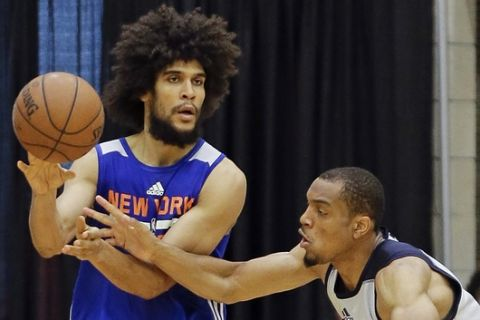 New York Knicks' Louis Labeyrie, left, passes the ball around Oklahoma City Thunder's Vince Hunter during the second half of an NBA summer league basketball game, Monday, July 3, 2017, in Orlando, Fla. (AP Photo/John Raoux)