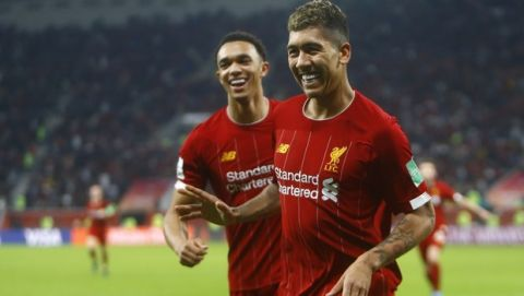 Liverpool's Roberto Firmino celebrates after scoring his side's second goal during the Club World Cup semifinal soccer match between Liverpool and Monterrey at the Khalifa International Stadium in Doha, Qatar, Wednesday, Dec. 18, 2019. (AP Photo/Hussein Sayed)
