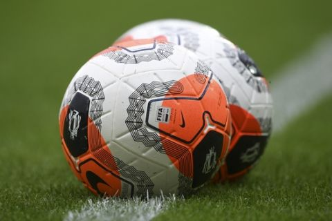 Balls lie on the pitch prior to the English Premier League soccer match between Norwich City and Brighton & Hove Albion at Carrow Road Stadium in Norwich, England, Saturday, July 4, 2020. (Joe Giddens/Pool Photo via AP)