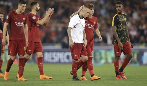 Roma players applaud the fans after the Champions League semifinal second leg soccer match between Roma and Liverpool at the Olympic Stadium in Rome, Wednesday, May 2, 2018. Liverpool win 7-6 on aggregate.(AP Photo/Andrew Medichini)