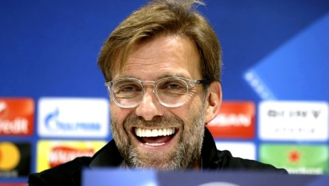 Liverpool manager Jurgen Klopp smiles during a press conference at Anfield, Liverpool, Britain, Monday, April 23, 2018, on the eve of their Champions League semifinal with AS Roma. (Martin Rickett/PA via AP)