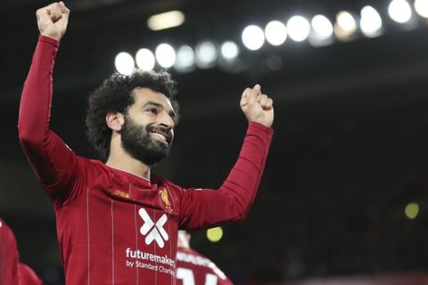 Liverpool's Mohamed Salah celebrates after scoring his side's second goal during the English Premier League soccer match between Liverpool and Tottenham Hotspur at Anfield stadium in Liverpool, England, Sunday, Oct. 27, 2019. (AP Photo/Jon Super)
