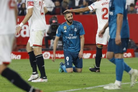 Real Madrid's Benzema, reacts during La Liga soccer match between Sevilla and Real Madrid at the Sanchez Pizjuan stadium, in Seville, Spain on Wednesday, May 9, 2018. (AP Photo/Miguel Morenatti)
