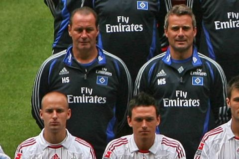 German first division Bundesliga soccer team Hamburger SV is seen during an official photocall in Hamburg, northern Germany, on Thursday, Jul. 26, 2007. Fourth row from left: Kitman Manfred Zielsdorf, Vincent Kompany, Collin Benjamin, Sebastian Langkamp, , Bastian Reinhardt, Otto Addo, Guy Demel, Joris Matthijsen, Kitman Miroslav Zadach. Third row from left: Team doctor Nikolai Linnewitsch, Physiotherapist Uwe Eplinius, Rafael van der Vaart, David Jarolim, Nigel de Jong, Sidney Sam, Masseur Lukas Ditczyk, Masseur Stefan Kliche, Physiotherapist Andrea Mueller. Second row from left: Coach Huub Stevens, Deputy coach Markus Schupp, Golie coach Claus Reitmaier, Anis Ben-Hatira, Paolo Guerrero, Maxim Choupo-Moting, Mario Fillinger, Thimothee Atouba, Athletic coach Markus Guenther, Diagnostician Manfred Duering. Front row from left: Mascot Dino, Miso Brecko, Piotr Trochowski, Raphael Wicky,  Frank Rost, Wolfgang Hesl, Rafael Wolf, Mohamed Zidan, Ivica Olic, and Kosi Saka  (AP Photo/Fabian Bimmer) ** Complete material, headshots, single player actions and more team features are available at <http://apimages.ap.org/unsecured/S.aspx?st=ps&id=520928&oid=150109>  **