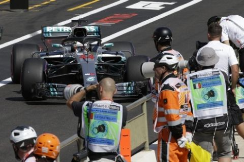 Mercedes driver Lewis Hamilton of Britain leaves pits during the second free practice at the Paul Ricard racetrack, in Le Castellet, southern France, Friday, June 22, 2018. The Formula one race will be held on Sunday. (AP Photo/Claude Paris)