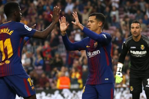 FC Barcelona's Coutinho, second left, celebrates after scoring during the Spanish La Liga soccer match between FC Barcelona and Villarreal at the Camp Nou stadium in Barcelona, Spain, Wednesday, May 9, 2018. (AP Photo/Manu Fernandez)