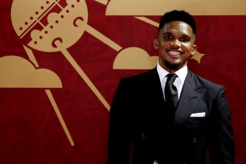Former soccer player of Cameroon Samuel Eto'o arrives for the 2018 soccer World Cup draw in the Kremlin in Moscow, Friday, Dec. 1, 2017. (AP Photo/Dmitri Lovetsky)