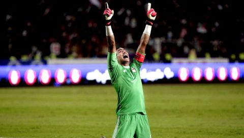 Egypt's goalkeeper Essam El Hadary, reacts after Egypt's Mohamed Salah scores the opening goal against Uganda, during the 2018 World Cup group E qualifying soccer match between Egypt and Uganda at the Borg El Arab Stadium in Alexandria, Egypt, Tuesday, Sept. 5, 2017. (AP Photo/Nariman El-Mofty)