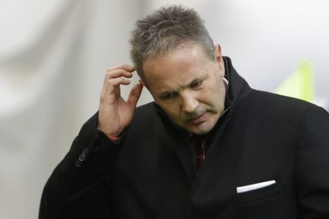 AC Milan coach Sinisa Mihailovic gestures as he walks prior to the start of a Serie A soccer match between AC Milan and Bologna, at the San Siro stadium in Milan, Italy, Wednesday Jan. 6, 2016. (AP Photo/Luca Bruno)