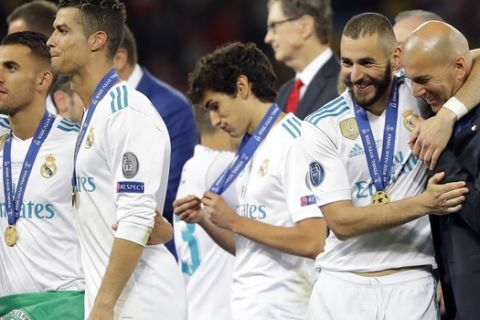 Real Madrid players celebrate after winning the Champions League Final soccer match between Real Madrid and Liverpool at the Olimpiyskiy Stadium in Kiev, Ukraine, Saturday, May 26, 2018. (AP Photo/Sergei Grits)