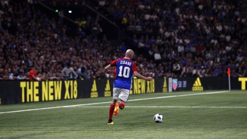 Former Real Madrid head coach Zinedine Zidane runs with the ball during a charity soccer match between members of the 1998 World Cup winning French team and a team of international veteran players who were also involved in the same tournament, at the U Arena in Nanterre, north of Paris, France, Tuesday, June 12, 2018. (AP Photo/Thibault Camus)