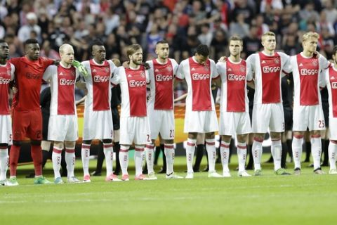 Ajax's team observe a minute of silence to commemorate the victims of the Manchester attack prior to the soccer Europa League final between Ajax Amsterdam and Manchester United at the Friends Arena in Stockholm, Sweden, Wednesday, May 24, 2017. (AP Photo/Michael Sohn)