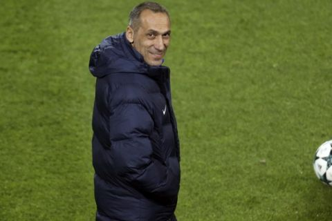 Apoel Nicosia coach Giorgos Donis smiles during a training session at Signal Iduna Park in Dortmund, Germany, Tuesday Oct. 31, 2017. Borussia Dortmund will play Apoel Nicosia on Wednesday in a Champions League match. (Ina Fassbender/dpa via AP)