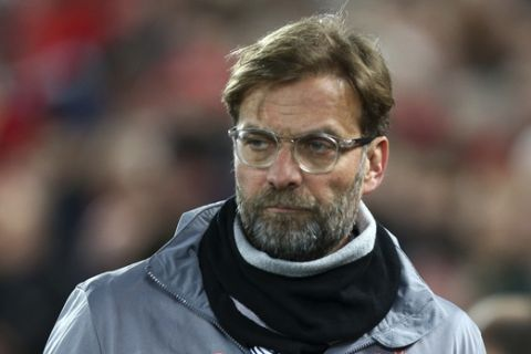 Liverpool coach Jurgen Klopp enters the field for the Champions League round of 16, second leg, soccer match between Liverpool and FC Porto at Anfield Stadium, Liverpool, England, Tuesday March 6, 2018. (AP Photo/Dave Thompson)