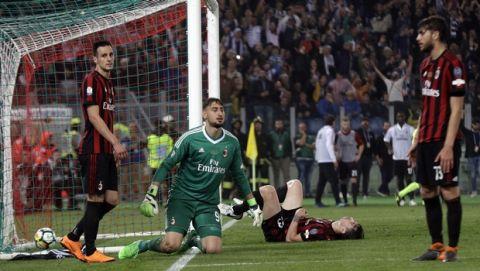 AC Milan's Nikola Kalinic, left, reacts after scoring an own goal during the Italian Cup final soccer match between Juventus and AC Milan, at the Rome Olympic stadium, Wednesday, May 9, 2018. (AP Photo/Gregorio Borgia)